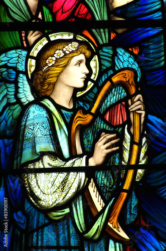 Fotografie, Obraz  Angel making music on a harp (stained glass)
