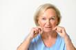 canvas print picture - Seniorin zieht an ihrer Haut im Gesicht