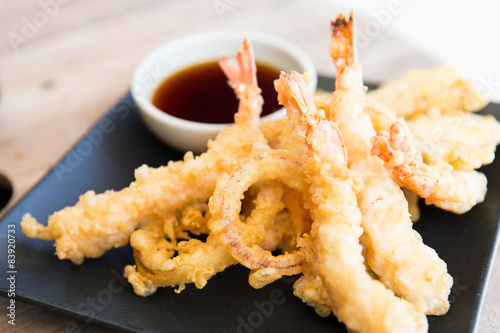 Fotografering  close up of deep-fried shrimps and soy sauce