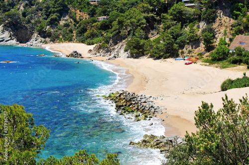 Carta da parati coves of Cala Llorell beach in Tossa de Mar, Spain