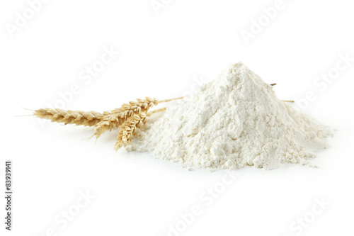 Vászonkép Heap of wheat flour with spikelets isolated on white