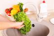 Vegetables washing in kitchen