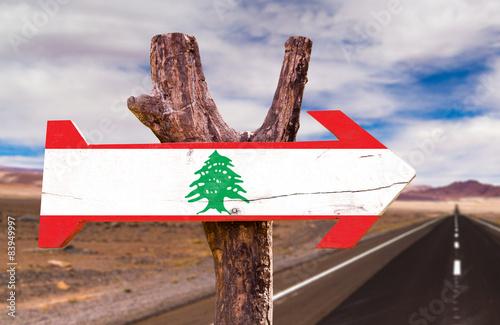 Poster Algerije Lebanon Flag wooden sign with desert road background