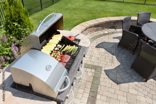 Fotografie, Obraz  Grilling food on an outdoor gas barbecue