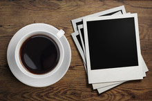 Coffee Cup And Polaroid Photo Frames On Table