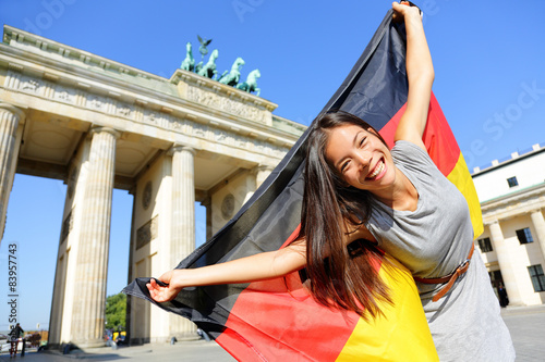 Fotografie, Obraz  German flag woman happy at Berlin Germany