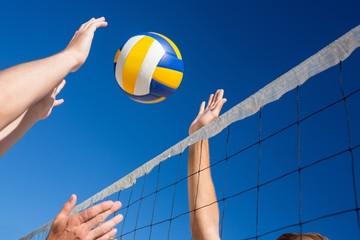 Fototapeta Friends playing volleyball