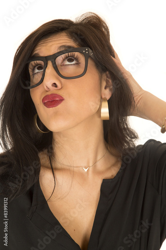 Fotografie, Obraz  Funny expression woman puckered lips looking up wearing geek gla