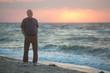 Man watching the sunrise on beach