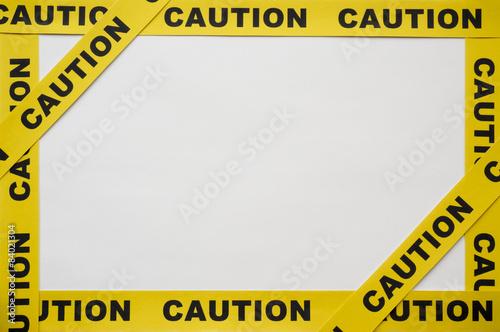 Fotografia  Yellow Caution tapes on white background