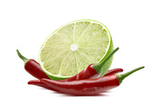 Lime Cut And Chili Pepper Isolated On White Background
