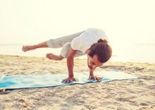 Man Doing Yoga Exercises Outdo...