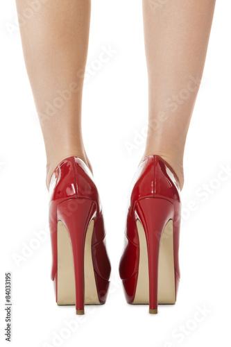 81618bac580 Attraktive weibliche Beine mit roten Stilettos…