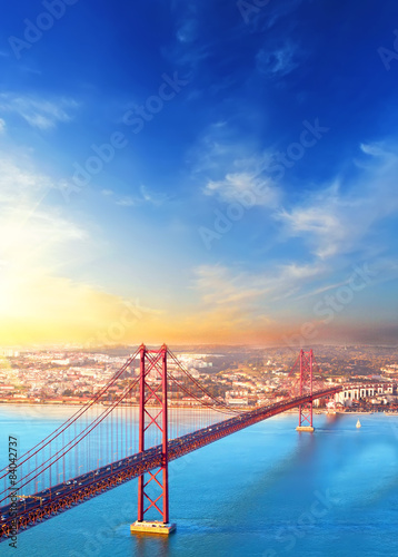 Red bridge at sunset, Lisbon, Portugal