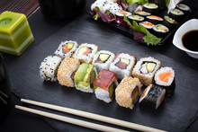 Sushi Rolls On Plate / Sushi Menu Assorted On The Table