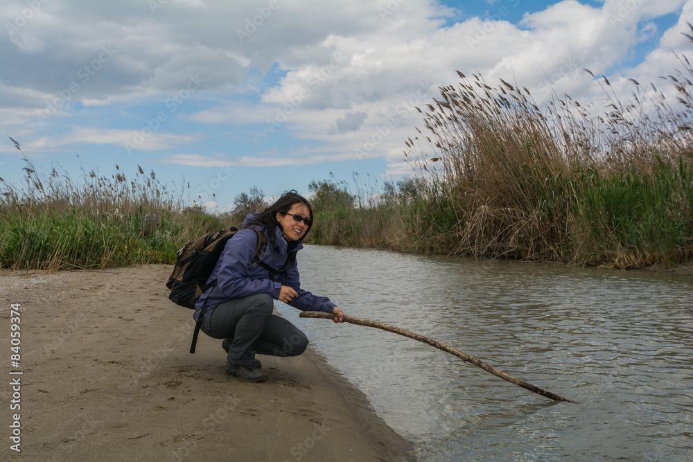 Fényképezés  Bautyful Asian woman hiking at Oasi del Simeto, Sicily, Italy