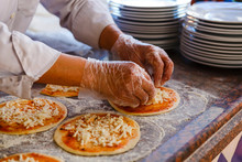 The Chef, Who Puts Toppings On A Pizza