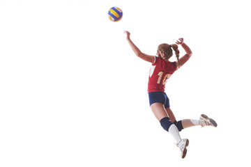 Obraz na Plexivolleyball woman jump and kick ball isolated on white background