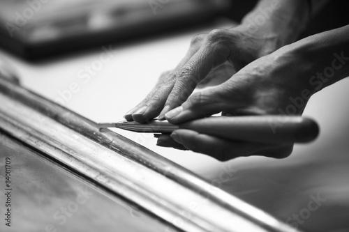Restauro cornice con bulino Canvas Print