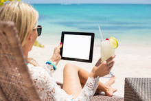 Relaxed Woman Using Tablet Com...