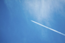 Airplane Contrail Against Clea...