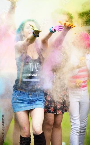Foto op Plexiglas Bedehuis Two girl during Holi festival throw color paints