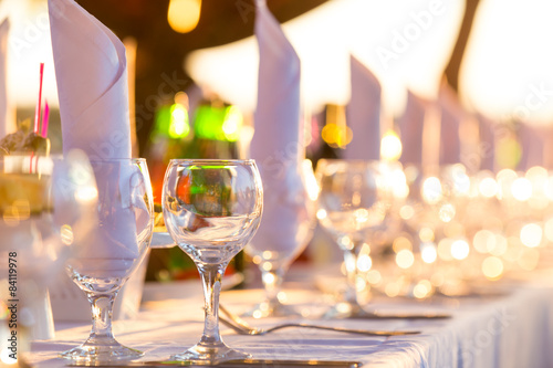 Served table for the banquet on the background of sunset Fototapete