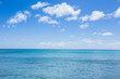 Leinwandbild Motiv seascape with clouds and blue sky background