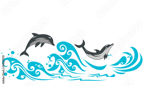 Fotografia Dolphins jumping in sea waves