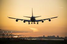 Plane Landing When Sunrise Sta...