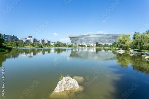 Fotografering  lake and modern building