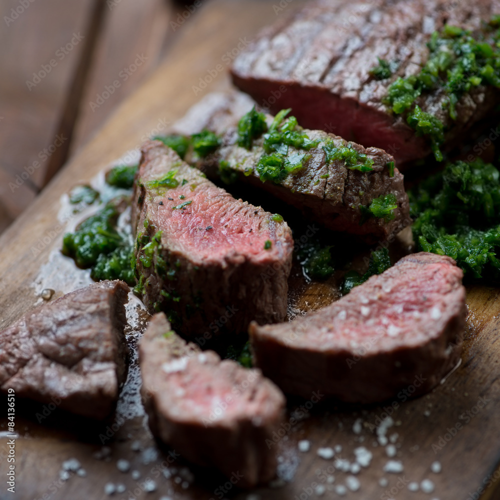 Medium rare grilled beef barbecue steak with chimichurri sauce Poster