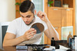 Man removing ear hair