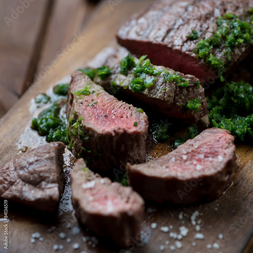 Medium rare grilled beef barbecue steak with chimichurri sauce Fototapet