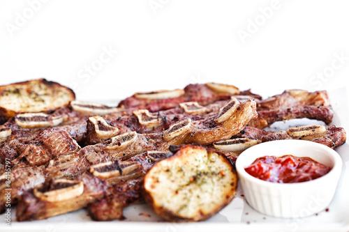 Fototapeta Delicious barbecued ribs seasoned with a spicy potato obraz na płótnie