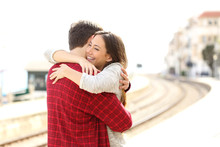 Couple Hugging Happy In A Train Station