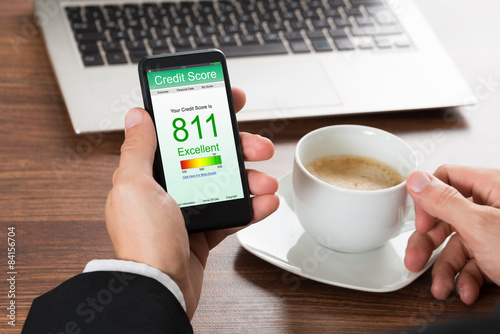 Fotografía  Businessman Checking Credit Score On Cellphone