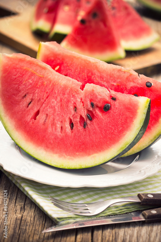 Fresh watermelon slices on the plate Poster