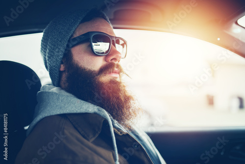 Fotografie, Obraz  bearded hipster wearing sunglasses inside car