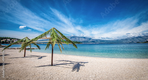 Poster Zanzibar Palm umbrellas on beach in Croatia