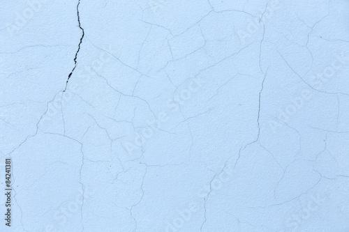 betonowa-cement-sciana-z-krekingowym-blekitnym-tlem