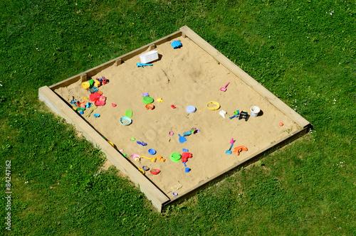 Fotografie, Obraz  Sandkasten mit Plastikspielzeug