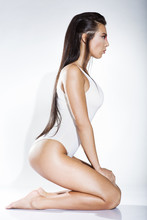 Sexy Young Woman Kneeling