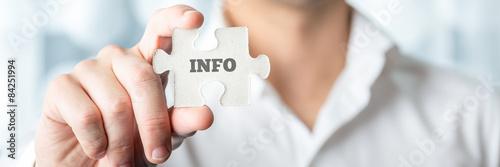 Fototapeta Businessman Showing Puzzle Piece with Info Text obraz