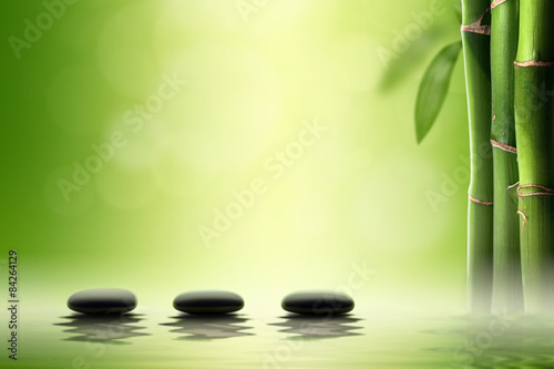 Photo  Zen concept. Black spa stones in bamboo forest.