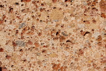 Pebble-embedded Stone Texture As A Background