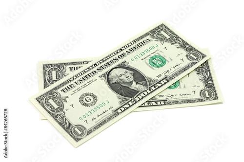 Fotografie, Obraz  Two new bills into one US dollar on a white background