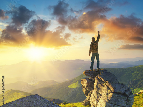 Canvas Print Silhouette of a champion on mountain peak. Active life concept