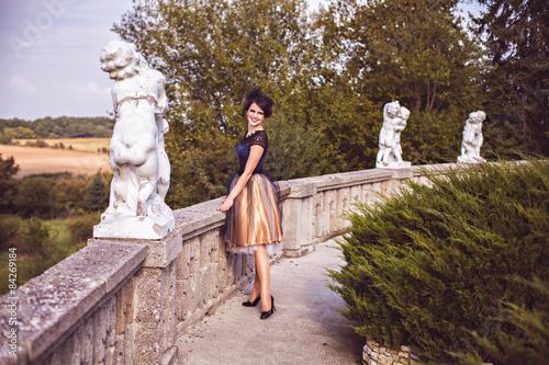 Fototapeta  Portrait of elegant brunette by the balustrade outdoor