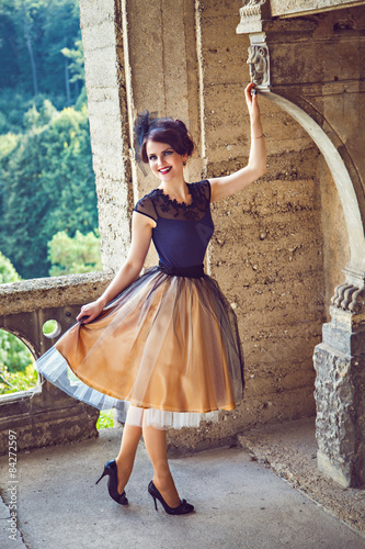 Fotografie, Obraz  Young refined lady on the balcony of the castle